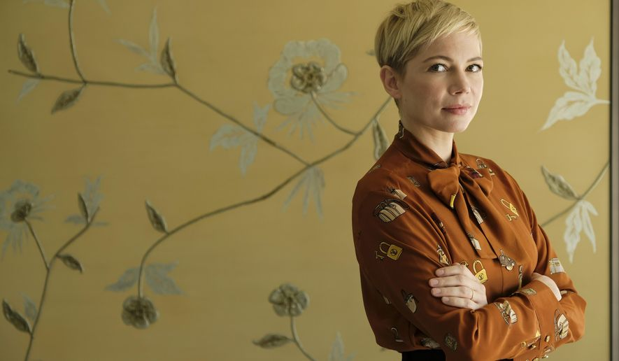 """This Sept. 27, 2018 photo shows Michelle Williams, a cast member in the film """"Venom,"""" posing for a portrait at the Four Seasons Hotel in Los Angeles. After years of fighting for privacy, Michelle Williams became an unlikely symbol for gender pay disparity in Hollywood. Now, 38, newly married and watching her daughter become a teenager, Williams has found a little more peace and is finding ways she can affect change, like doing a big superhero movie for first time, and making sure her character is one for the #MeToo age. (Photo by Chris Pizzello/Invision/AP)"""