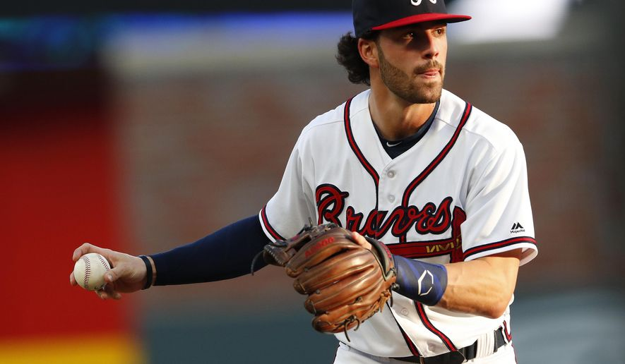 FILE - In this May 30, 2018, file photo, Atlanta Braves shortstop Dansby Swanson (7) warms up before the first inning of a baseball game against the New York Mets, in Atlanta. The Braves are trying to determine the status of shortstop Dansby Swanson, who has a sore wrist, as they prepare to open their NLDS against the Los Angeles Dodgers .(AP Photo/John Bazemore, File)