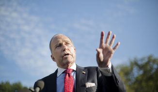 White House chief economic adviser Larry Kudlow gestures as he answers questions for members of the media outside the West Wing of the White House in Washington, Tuesday, Oct. 2, 2018. Ludlow answered questions about the new United States-Mexico-Canada Agreement, or USMCA. It replaces the 24-year-old North American Free Trade Agreement, which President Donald Trump had called a job-killing disaster. (AP Photo/Pablo Martinez Monsivais)