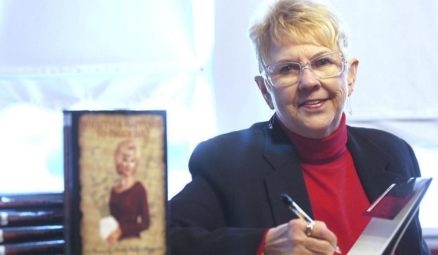 """FILE - In this Jan. 11, 2008, file photo, Peggy Sue Gerron unveils her new book """"What Ever Happened to Peggy Sue"""" during a press conference in Tyler, Texas. Gerron, the Texas woman who inspired the 1958 Buddy Holly song """"Peggy Sue"""" has died at a Lubbock hospital. Gerron Rackham of Lubbock died Monday, Oct. 1, 2018, at University Medical Center. She was 78. (Jaime R. Carrero/Tyler Morning Telegraph, via AP, File)"""