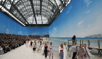 Models wear creations for Chanel Spring/Summer 2019 ready-to-wear fashion collection in Paris, Tuesday, Oct.2, 2018. (AP Photo/Christophe Ena)