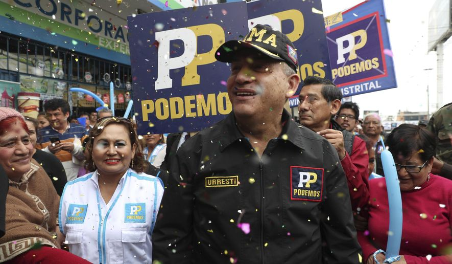 In this Friday, Sept. 28, 2018 photo, confetti rains on mayoral candidate Daniel Unrest as he arrives for a campaign event in Lima, Peru. A leading candidate to be Lima's next mayor, the retired army general promised an iron fist against criminals in Peru's massive capital city. (AP Photo/Martin Mejia)