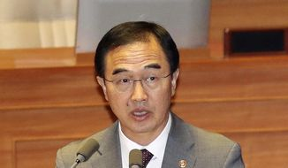In this Oct. 1, 2018 photo, South Korean Unification Minister Cho Myoung-gyon speaks at the National Assembly in Seoul, South Korea.  South Korea says North Korea is estimated to have up to 60 nuclear weapons. Unification Minister Cho told parliament the estimates on the size of North Korea's nuclear arsenal range from 20 bombs to as many as 60.(Kim Hyun-tae/Yonhap via AP)