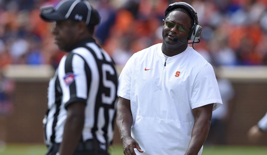 Syracuse head coach Dino Babers reacts to an officials call during the second half of an NCAA college football game against Clemson, Saturday, Sept. 29, 2018, in Clemson, S.C. Clemson won 27-23. (AP Photo/Richard Shiro)