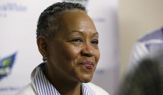 """FILE - In this May 21, 2016, file photo, WNBA President Lisa Borders smiles as she speaks to reporters before a WNBA basketball game between the San Antonio Stars and the Dallas Wings in Arlington, Texas. TIME'S UP has named Borders as its first president and CEO. In a statement Tuesday, Oct. 2, 2018, the organization said Borders will lead the organization's efforts to """"ensure equal opportunity and protection for all working women."""" (AP Photo/LM Otero, File)"""