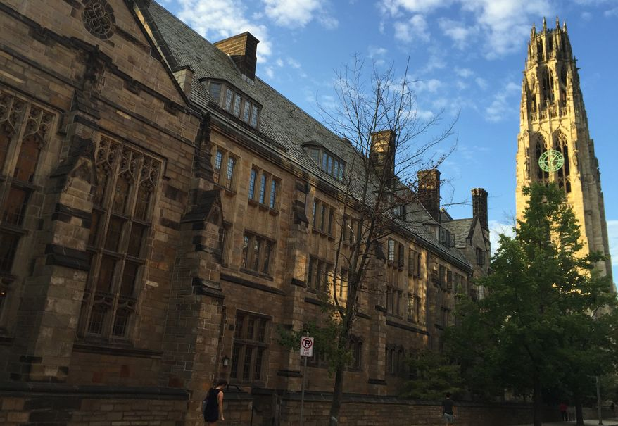 This Sept. 9, 2016, file photo shows Harkness Tower on the campus of Yale University in New Haven, Conn. (AP Photo/Beth J. Harpaz)
