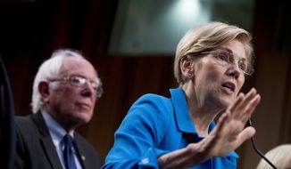 "Sen. Elizabeth Warren, D-Mass., right, accompanied by Sen. Bernie Sanders, I-Vt., left, speaks during a news conference on Capitol Hill in Washington, Wednesday, Sept. 13, 2017, to unveil their ""Medicare for All"" legislation to reform health care. (AP Photo/Andrew Harnik) ** FILE **"