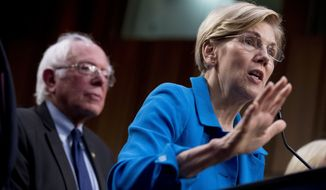 Sen. Elizabeth Warren, D-Mass., right, accompanied by Sen. Bernie Sanders, I-Vt., left, speaks during a news conference on Capitol Hill in Washington, Wednesday, Sept. 13, 2017, to unveil their Medicare for All legislation to reform health care. (AP Photo/Andrew Harnik)