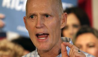 FILE- In this Sept. 6, 2018 file photo, Fla. Gov. Rick Scott speaks at a Republican rally in Orlando, Fla. Incumbent Democratic Sen. Bill Nelson and challenger Gov. Rick Scott meet in the first of several debates in their campaign for a highly competitive U.S. Senate seat Tuesday, Oct. 2, 2018 in Miramar, Fla. (AP Photo/John Raoux, File)