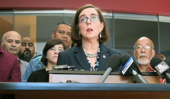 In this May 27, 2017, file photo, Oregon Gov. Kate Brown speaks at a news conference in Portland, Ore. Brown on Wednesday, Oct. 3, 2018, announced legislation that would maintain Oregon's water and air quality rules at the same level or higher than they were the day before President Donald Trump took office. (AP Photo/Gillian Flaccus, File)