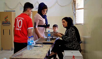 Iraqi Kurds participate in parliamentary elections in Irbil, Iraq, Sunday, Sept. 30, 2018. Iraq's self-ruled Kurdish region held long-delayed parliamentary elections on Sunday, a year after a vote for independence sparked a punishing backlash from Baghdad, leaving Kurdish leaders deeply divided. (AP Photo/Salar Salim)