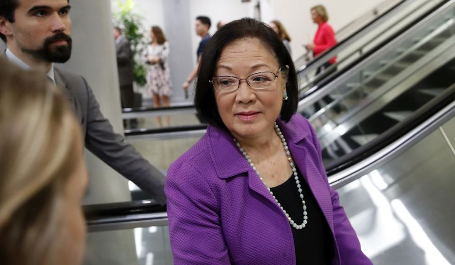 Sen. Mazie Hirono, D-Hawaii, listens to a reporter's question on Capitol Hill, Wednesday, Oct. 3, 2018 in Washington. (AP Photo/Alex Brandon)