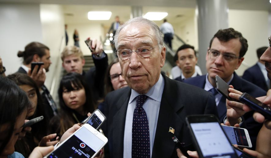Senate Judiciary Committee Chairman Chuck Grassley, R-Iowa, talks with reporters on Capitol Hill, Wednesday, Oct. 3, 2018 in Washington. (AP Photo/Alex Brandon)