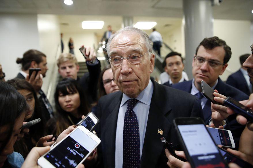 Senate Judiciary Committee Chairman Chuck Grassley, R-Iowa, talks with reporters on Capitol Hill, Wednesday, Oct. 3, 2018 in Washington. (AP Photo/Alex Brandon)