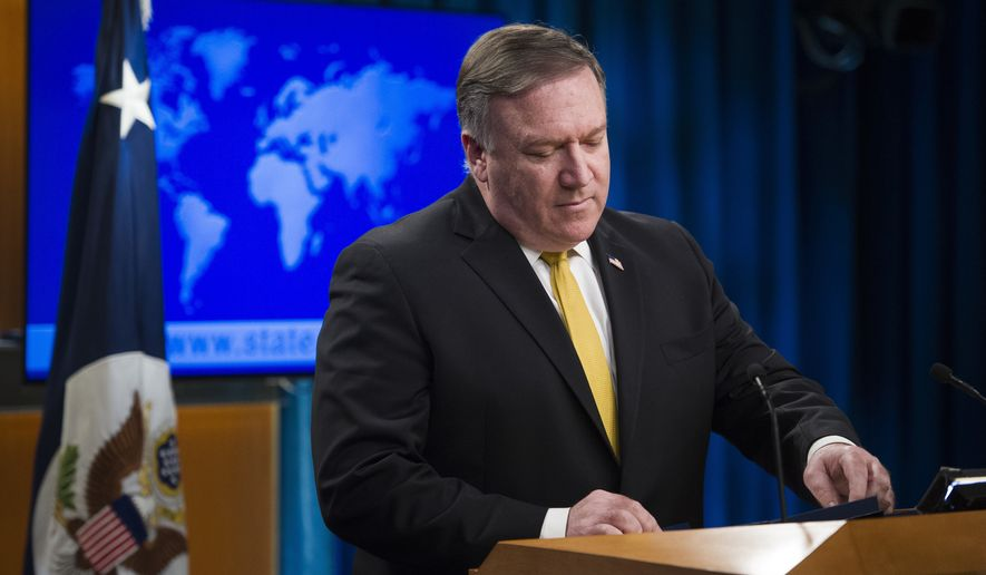 Secretary of State Mike Pompeo briefs reporters at the State Department in Washington, Wednesday, Oct. 3, 2018.  Pompeo has announced that the U.S. is canceling a 1955 treaty with Iran establishing economic relations and consular rights between the two nations. (AP Photo/Cliff Owen)