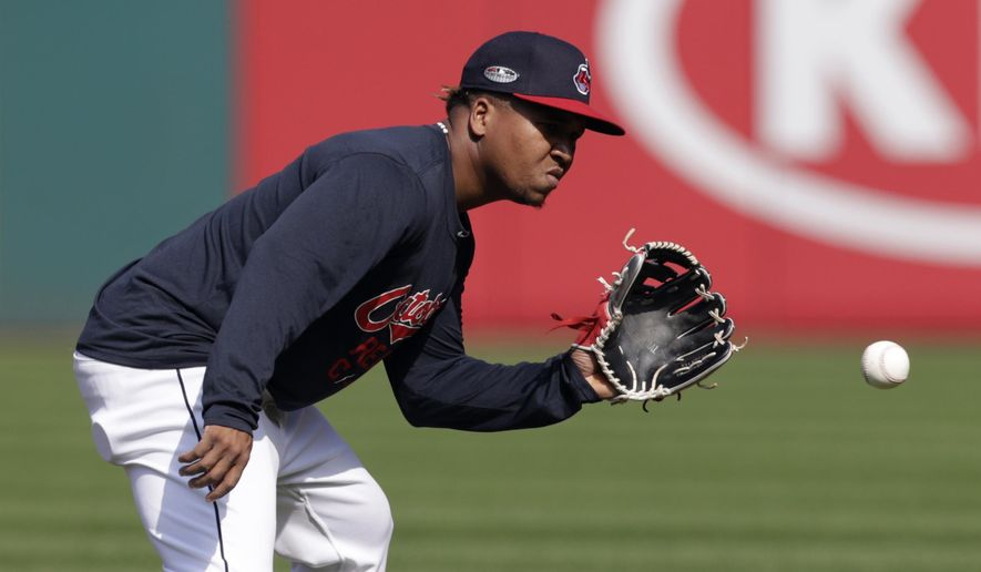 Cleveland Indians' Jose Ramirez fields a ball during a baseball workout, Wednesday, Oct. 3, 2018, in Cleveland. The Indians play the Houston Astros in Game 1 of the American League division series on Friday in Houston. (AP Photo/Tony Dejak)