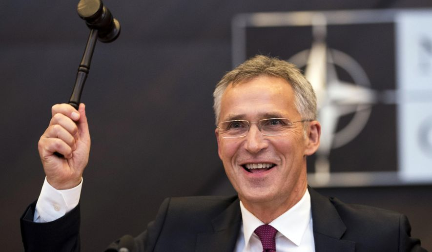 NATO's Secretary General Jens Stoltenberg hits a hammer to start the session during a meeting of the North Atlantic Council at a gathering of NATO defence ministers at NATO headquarters in Brussels, Wednesday, Oct. 3, 2018. (AP Photo/Francisco Seco)