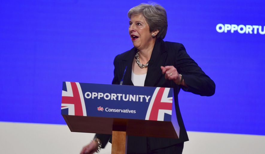 Britain's Prime Minister Theresa May dances as she arrives on stage to make her speech at the Conservative Party annual conference at the International Convention Centre, Birmingham, England, Wednesday, Oct. 3, 2018. (Victoria Jones/PA via AP)