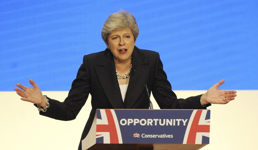 Conservative Party Leader and Prime Minister Theresa May addresses delegates during a speech at the Conservative Party Conference at the ICC, in Birmingham, England, Wednesday, Oct. 3 , 2018. (AP Photo/Rui Vieira)