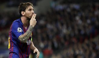Barcelona forward Lionel Messi celebrates after scoring his side's third goal during the Champions League Group B soccer match between Tottenham Hotspur and Barcelona at Wembley Stadium in London, Wednesday, Oct. 3, 2018. (AP Photo/Kirsty Wigglesworth)