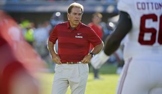 FILE - In this Saturday, Sept. 15, 2018, file photo, Alabama head coach Nick Saban watches his players during warmups before an NCAA college football game against Mississippi in Oxford, Miss. Since every conference now plays a conference championship game, seven is the most possible undefeated teams on Dec. 3, the College Football Playoffs selection Sunday. But only the SEC managed to get through the first month of the season with a possibility of a matchup of unbeaten in its title game on championship weekend.  (AP Photo/Rogelio V. Solis, File)