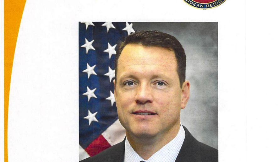 This image shows a page of U.S. Drug Enforcement Administration Regional Director Richard Dobrich's portfolio. Dobrich, the U.S. Drug Enforcement Administration's top official in Colombia is retiring amid an internal investigation of alleged misconduct. The probe includes an anonymous complaint obtained by The Associated Press that accused Dobrich of hiring prostitutes. (Courtesy of Dobrich via AP)
