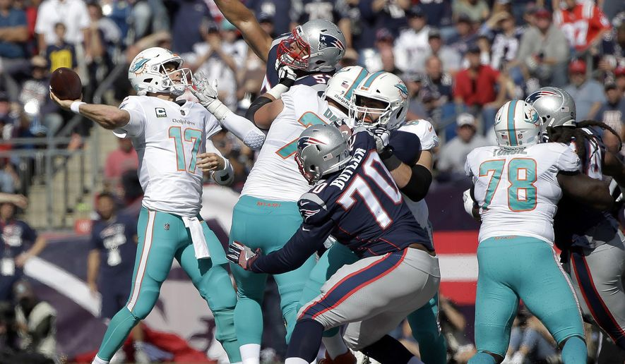 FILE - In this Sunday, Sept. 30, 2018, file photo, New England Patriots defensive tackle Adam Butler (70) and linebacker Kyle Van Noy, rear, pressure Miami Dolphins quarterback Ryan Tannehill (17) during the first half of an NFL football game in Foxborough, Mass.  The Dolphins were dominated in the trenches in a 38-7 defeat, and to have a chance Sunday at Cincinnati, they'll need significant improvement up front. (AP Photo/Steven Senne, File)