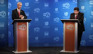 Gubernatorial candidates left, republican incumbent Gov. Bruce Rauner, and right, democratic challenger JB. Pritzker, before their televised debate at the ABC 7 studios, in Chicago, on Wednesday Oct. 3, 2018.  (Nuccio DiNuzzo/Chicago Tribune via AP, Pool)