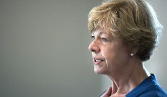 "FILE - In this Sept. 20, 2018 file photo, Sen. Tammy Baldwin speaks to supporters in Janesville, Wis. Republican U.S. Senate candidate Leah Vukmir told Democratic Sen. Baldwin on Wednesday, Oct. 3, 2018, that ""your lies are spiraling,"" as Baldwin and Democrats unleashed more attacks on Vukmir's record with the election less than five weeks away. (Angela Major /The Janesville Gazette via AP, File)"
