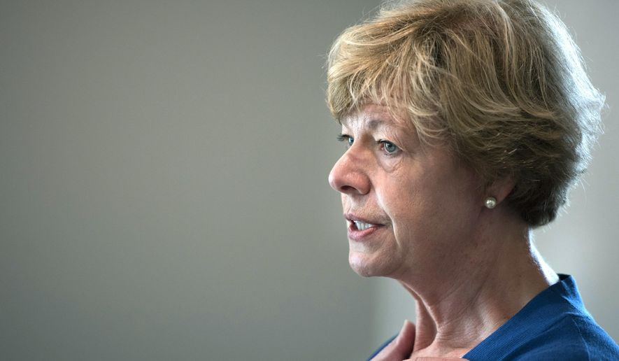"""FILE - In this Sept. 20, 2018 file photo, Sen. Tammy Baldwin speaks to supporters in Janesville, Wis. Republican U.S. Senate candidate Leah Vukmir told Democratic Sen. Baldwin on Wednesday, Oct. 3, 2018, that """"your lies are spiraling,"""" as Baldwin and Democrats unleashed more attacks on Vukmir's record with the election less than five weeks away. (Angela Major /The Janesville Gazette via AP, File)"""