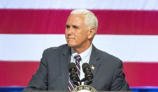 Vice President Mike Pence speaks at a campaign event for Republican U.S. Rep. Cathy McMorris Rodgers at the Spokane Convention Center Tuesday, Oct. 2, 2018, in Spokane, Wash. Pence came to downtown Spokane to stump for McMorris Rodgers, who faces a strong challenge this year from Democrat Lisa Brown. (Jesse Tinsley/The Spokesman-Review via AP)