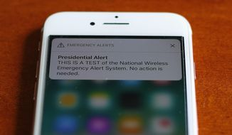The first test of the national wireless emergency system by the Federal Emergency Management Agency is shown on a cellular phone in Detroit, Wednesday, Oct. 3, 2018. About 225 million electrtonic devices across the United States received alerts from FEMA Wednesday afternoon. (AP Photo/Paul Sancya)