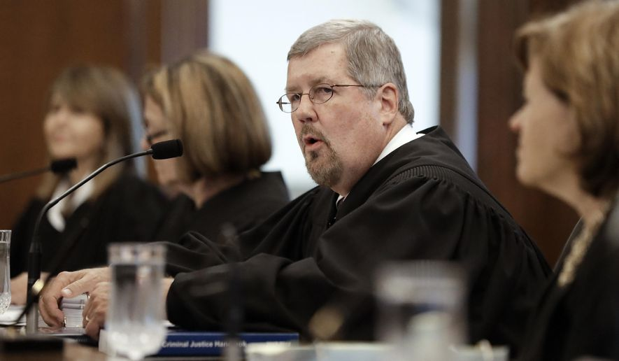 Tennessee Supreme Court Chief Justice Jeffrey S. Bivins, second from right, speaks as the court hears arguments regarding the state's use of a three-drug cocktail for executions Wednesday, Oct. 3, 2018, in Nashville, Tenn. With an execution scheduled for next week, 32 death row inmates are asking Tennessee's high court to declare the state's lethal injection method unconstitutional. (AP Photo/Mark Humphrey)