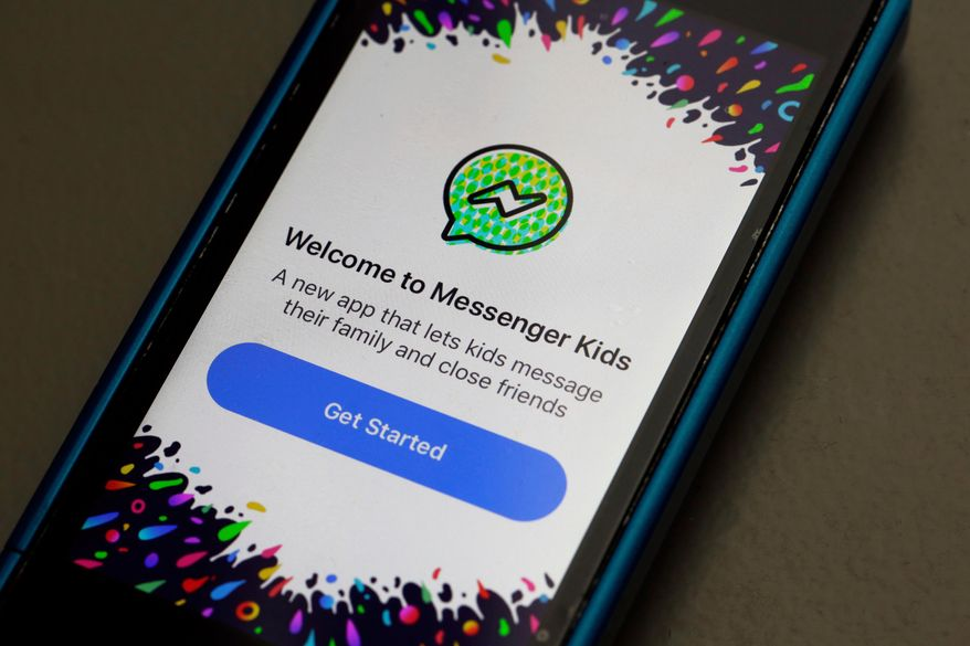In this Feb. 16, 2018, file photo, Facebook's Messenger Kids app is displayed on an iPhone in New York. (AP Photo/Richard Drew, File)