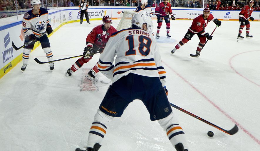 Oiler's Ryan Strome controls the puck during a hockey test match between Koelner Haie (Cologne Sharks) and the Edmonton Oilers in Cologne, Germany, Wednesday, Oct. 3, 2018. (AP Photo/Michael Probst)