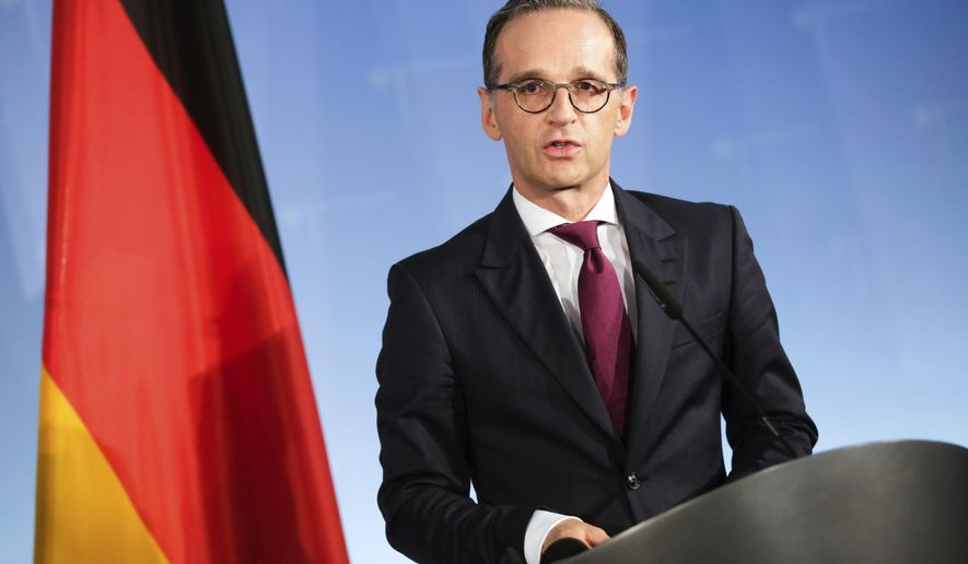 FILE - In this Sept. 14, 2018 file photo German Foreign Minister Heiko Maas attends a joint news conference with Russian Foreign Minister Sergey Lavrov at the Foreign Ministry in Berlin.. (AP Photo/Markus Schreiber, file)