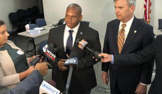 Kentucky Education Commissioner Wayne Lewis, left, and State Board of Education chairman Hal Heiner speak with reporters about new minimum high school graduation requirements on Wednesday, Oct. 3, 2018, in Frankfort, Ky. (AP Photo/Adam Beam)