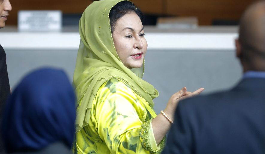 Rosmah Mansor, wife of Malaysian Prime Minister Najib Razak, arrives at the Anti-Corruption Agency for questioning in Putrajaya, Wednesday, Oct. 3, 2018. Rosmah is to be questioned by the country's anti-graft agency for the third time as investigators prepare possible charges against her including money laundering in the multi-billion-dollar scandal. (AP Photo/Vincent Thian)