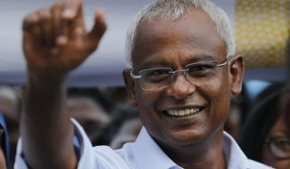 FILE - In this Monday, Sept. 24, 2018, file photo, Ibrahim Mohamed Solih, the president-elect of the Maldives interacts with his supporters during a gathering in Male, Maldives. Solih has scored another victory Wednesday by securing a majority in Parliament after the Elections Commission restored 12 lawmakers who were earlier deemed to have lost their seats. (AP Photo/Eranga Jayawardena, File)