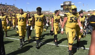 FILE - In this Sept. 22, 2018, file photo, the Missouri football team walks off the field after losing 43-29 to Georgia in an NCAA college football game, in Columbia, Mo. The bye week came at a good time for Missouri, which hung with Georgia before mistakes wound up biting them. (AP Photo/L.G. Patterson, File)