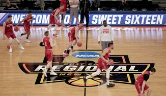 FILE - In this March 23, 2017, file photo, Wisconsin players dribble across the court during practice at Madison Square Garden in New York. Defending national champion Villanova will play at least three times at Madison Square Garden during the upcoming season, part of a 2018-19 college basketball schedule that also features Duke, Kentucky and Syracuse visiting The World's Most Famous Arena. Florida, Maryland, Notre Dame, Oklahoma, Oregon and West Virginia are among the other programs headed to MSG. (AP Photo/Julie Jacobson, File)