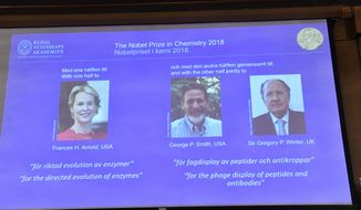 The 2018 Nobel Prize laureates for Chemistry are shown on the screen from left, Frances H Arnold of the US, George P Smith of the US, and Gregory P Winter of Britain, during the announcement at the Royal Swedish Academy of Sciences in Stockholm, Tuesday Oct. 3, 2018. (Jonas Ekstromer/TT via AP)