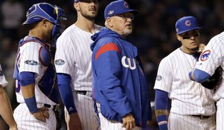 Chicago Cubs manager Joe Maddon talks to his team during the 13th inning of the National League wild-card playoff baseball game against the Colorado Rockies, Tuesday, Oct. 2, 2018, in Chicago. The Rockies won 2-1. (AP Photo/Nam Y. Huh)