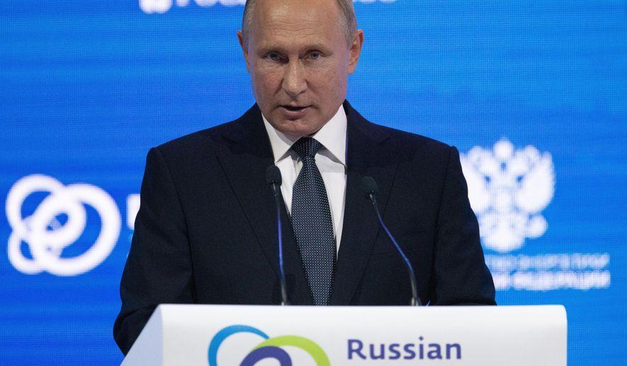 Russian President Vladimir Putin speaks at the Russian Energy Week International Forum in Moscow, Russia, Wednesday, Oct. 3, 2018. (AP Photo/Alexander Zemlianichenko, Pool)