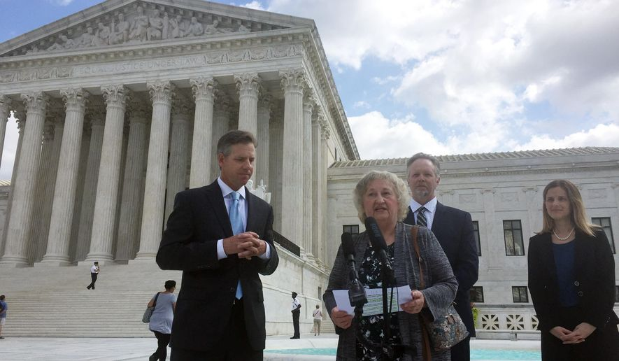 Pennsylvania resident Rose Mary Knick speaks outside the Supreme Court, Wednesday, Oct. 3, 2018 in Washington, alongside her attorneys J. David Breemer, left, Brian Hodges and Christina Martin. Knick is at the center of a case the Supreme Court is hearing that stems from her dispute with her town over an ordinance that says landowners who have cemeteries on their properties must make them open to the public during daylight hours. (AP Photo/Jessica Gresko)