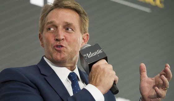 Sen. Jeff Flake, R-Ariz. participates in an interview at the The Atlantic's 'The Constitution in Crisis' forum in Washington, Tuesday, Oct. 2, 2018.  (AP Photo/Cliff Owen) **FILE**