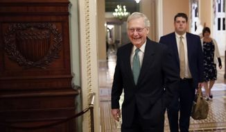 Senate Majority Leader Mitch McConnell of Ky., left, walks out of his office on Capitol Hill, Wednesday, Oct. 3, 2018 in Washington. (AP Photo/Alex Brandon)