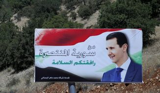 """FILE - In this July 20, 2018 file photo, a poster of Syrian President Bashar Assad with Arabic that reads """"Welcome in victorious Syria,"""" is displayed on the border between Lebanon and Syria. Assad told a little-known Kuwaiti newspaper that Syria has reached a """"major understanding"""" with other Arab states after years of hostility over the country's civil war. The interview published Wednesday, Oct. 3, 2018, in the Al-Shahed newspaper, was Assad's first with a Gulf newspaper since the war began in 2011. (AP Photo/Hassan Ammar, File)"""