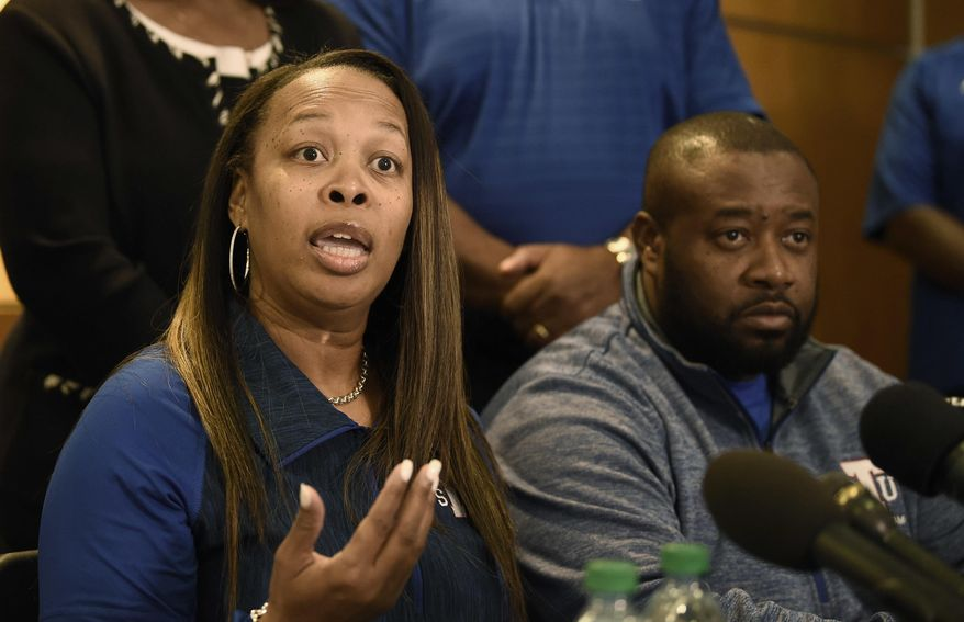 Staci Abercrombie, left, talks about her son, Tennessee State football player Christion Abercrombie, during a news conference Wednesday, Oct. 3, 2018, in Nashville, Tenn. Abercrombie suffered a severe head injury in an NCAA college football game last week. At right is Derrick Abercrombie, Staci's husband. (Lacy Atkins/The Tennessean via AP)