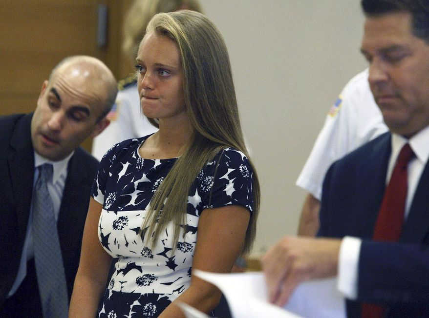 FILE - In this July 29, 2016, file photo, Michelle Carter stands with her attorneys at the Bristol County Juvenile Court in Taunton, Mass. On Thursday, Oct. 4, 2018, Massachusetts' highest court will hear Carter's appeal of her 2017 conviction for involuntary manslaughter. As a teenager, she sent her boyfriend text messages urging him to kill himself, which he did in July 2014. (George Rizer/The Globe via AP, Pool, File)